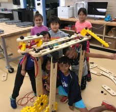 students building with teacher